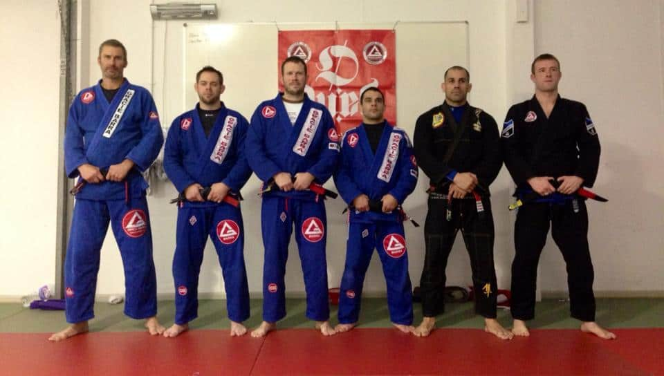 James Hodges' (right) pictured after receiving his black belt